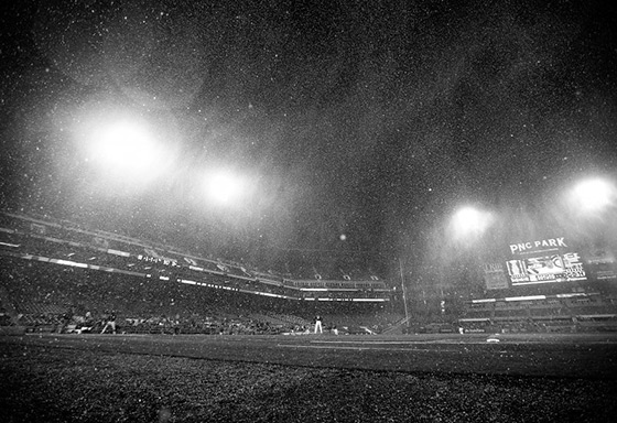 PITTSBURGH, PA – APRIL 22: (EDITORS NOTE: Image has been converted to black and white.) Sleet falls onto the field in the top of the seventh inning during the game between the Pittsburgh Pirates and the Chicago Cubs at PNC Park on April 22, 2015 in Pittsburgh, Pennsylvania. (Photo by Jared Wickerham/Getty Images)