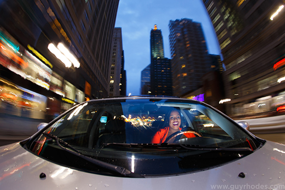 Lyft ride-sharing service driver Angelica Griffin in downtown Chicago, Ill., Tuesday, March 24, 2015. Griffin, originally from Georgia, is studying for her law degree at DePaul University. Photo by Guy Rhodes