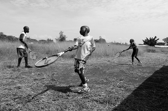 Boys from Kisumu, Kenya practice tennis outside of the courts during the Nyanza Open Tennis Championships on August 30, 2014. Many entered into the tournament are beneficiaries of the free Saturday lessons and equipment provided to kids from less affluent areas of Kisumu.