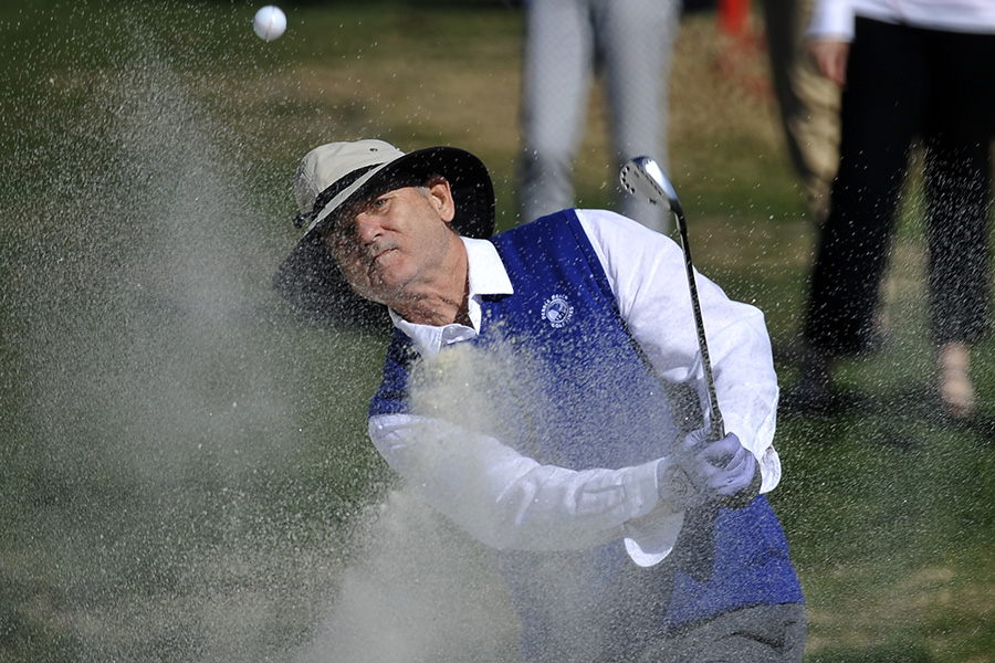 Actor Bill Murray chips out of the sand on the 17th hole at Pebble Beach Golf Links during the 2016 AT&T Pebble Beach Pro-Am.
