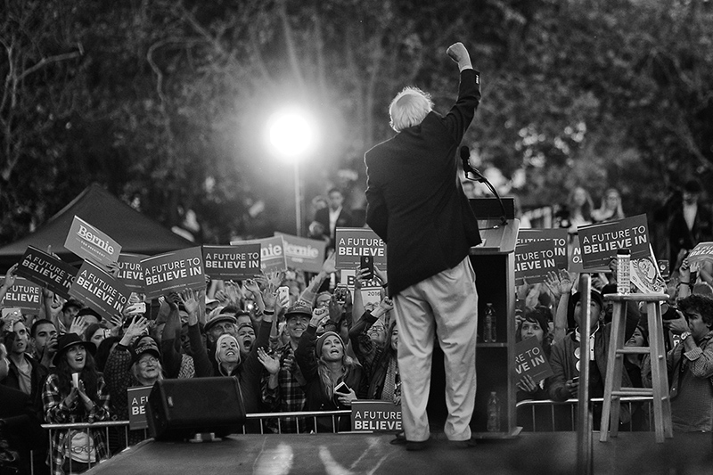Sen. Bernie Sanders pumps his fist in the air after speaking at a rally of thousands at Colton Hall in Monterey, Calif. on May 31, 2016.