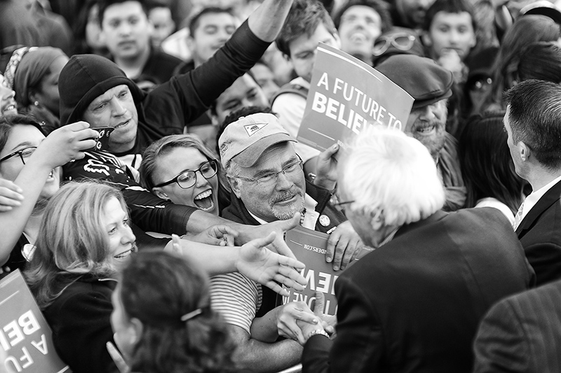 Sanders shakes hands with supporters after the rally.
