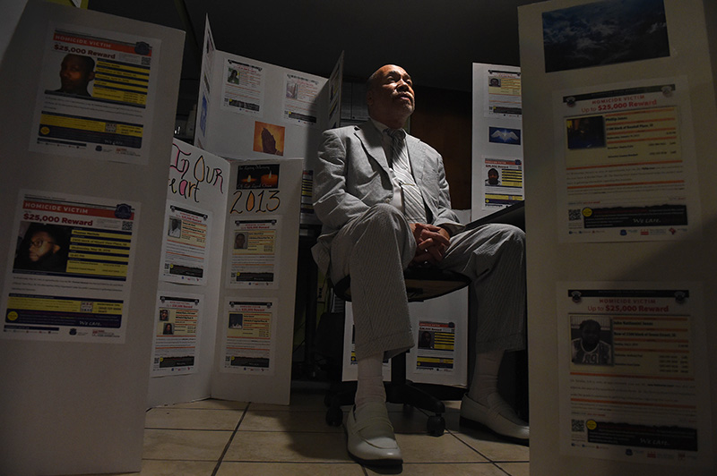 Activist Phillip Parnell, 65, is seen in a portrait surrounded by many of the panels he has created in efforts to highlight the city's failure to solve homicides east of the Anacostia River, an area of the city that is predominantly African American Wednesday, June 22, 2016 in Washington, D.C. (Photo by Christian K. Lee/The Washington Post)