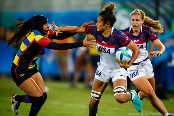 Aug 6, 2016; Rio de Janeiro, Brazil; Colombia forward Isabel Cristina Romero Benitez (6) gets a hand to her face by USA forward Nana Faavesi (9) as Faavesi runs the ball during a rugby sevens match between the USA and Colombia at Deodoro Stadium in the Rio 2016 Summer Olympic Games. Mandatory Credit: Guy Rhodes-USA TODAY Sports
