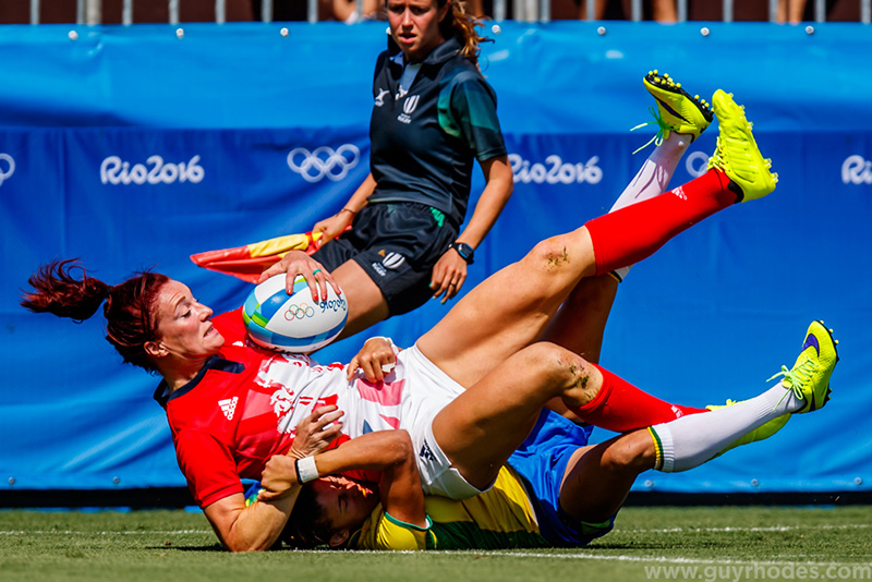 Aug 6, 2016; Rio de Janeiro, Brazil; Great Britain back Joanne Watmore (10) is tackled by Brazil back Jaqueline Claudia Tells (12) during a match between Great Britain and Brazil at Deodoro Stadium at the Rio 2016 Summer Olympic Games. Mandatory Credit: Guy Rhodes-USA TODAY Sports