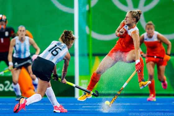 Aug 15, 2016; Rio de Janeiro, Brazil; Argentina midfield Florencia Habif (16) shoots against Netherlands midfield Laurien Leurink (6) during the women's field hockey quarterfinals in the Rio 2016 Summer Olympic Games at Olympic Hockey Centre. Mandatory Credit: Guy Rhodes-USA TODAY Sports
