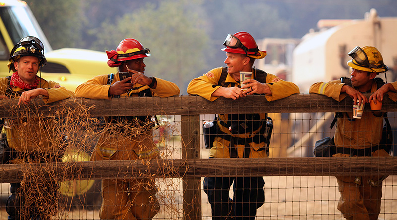 A strike team crews from the Alameda County Fire Department take a break while on patrol in Cachagua on Wednesday evening while watching the Soberanes Fire on August 3.