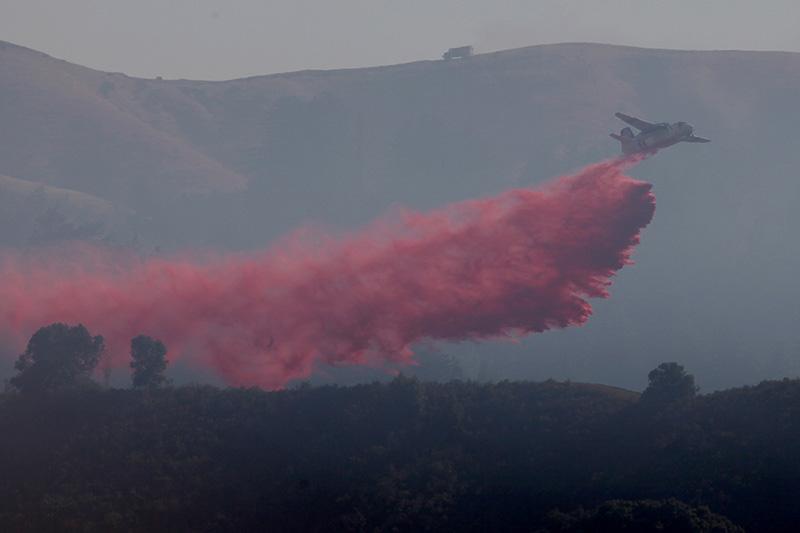 A tanker plane drops fire retardant on the Soberanes Fire on July 28.