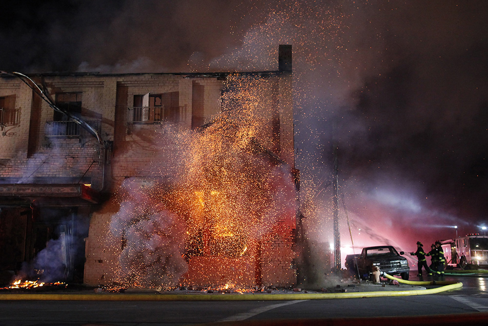 The burning roof of the first floor collapses as firefighters work to contain a massive blaze that consumed The Swinging Door building on Soledad Street in Salinas' Chinatown on Saturday, March 18, 2017.