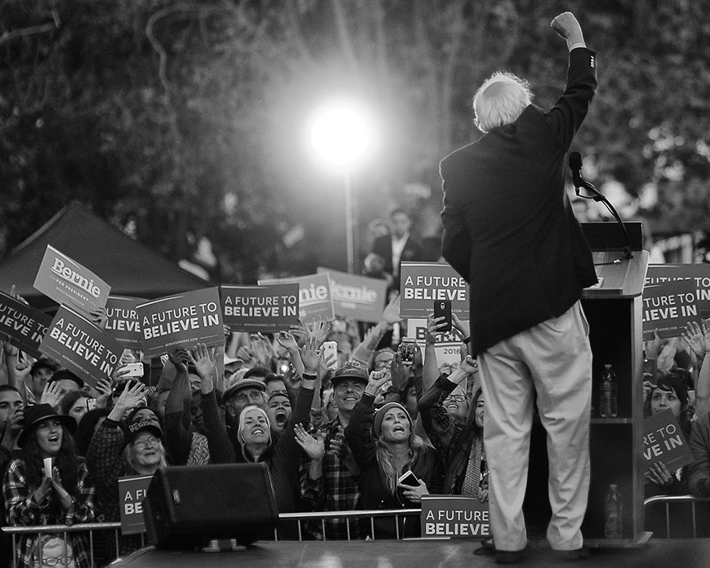 Sen. Bernie Sanders pumps his fist in front of thousands of supporters after delivering his stump speech outside of Colton Hall in Monterey, Calif. on May 31, 2016.