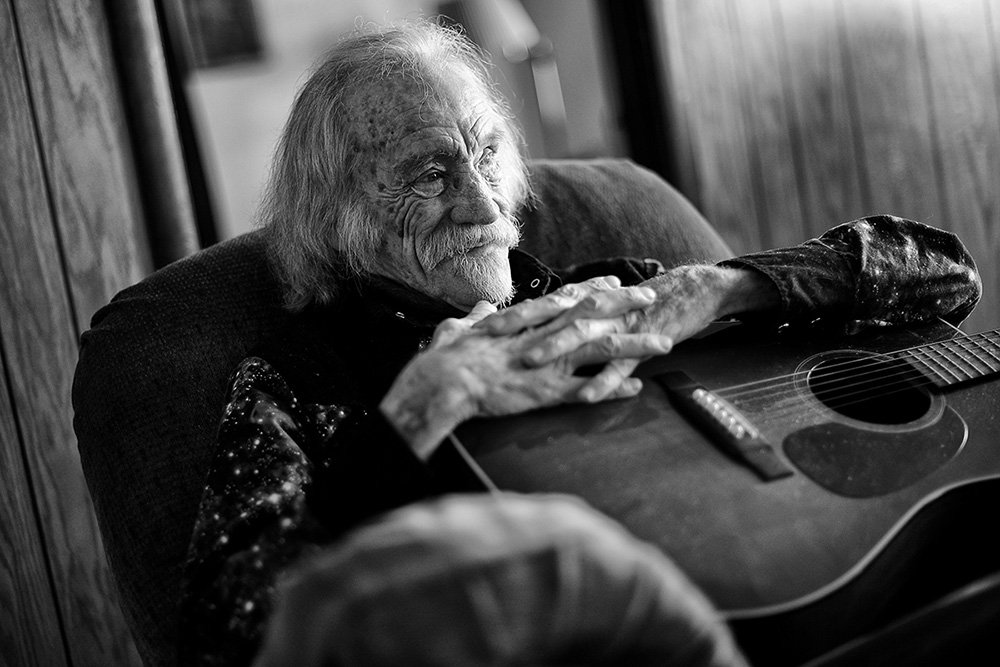 America singer-songwriter Larry Hosford sits in his home in Salinas, Calif. in 2014.