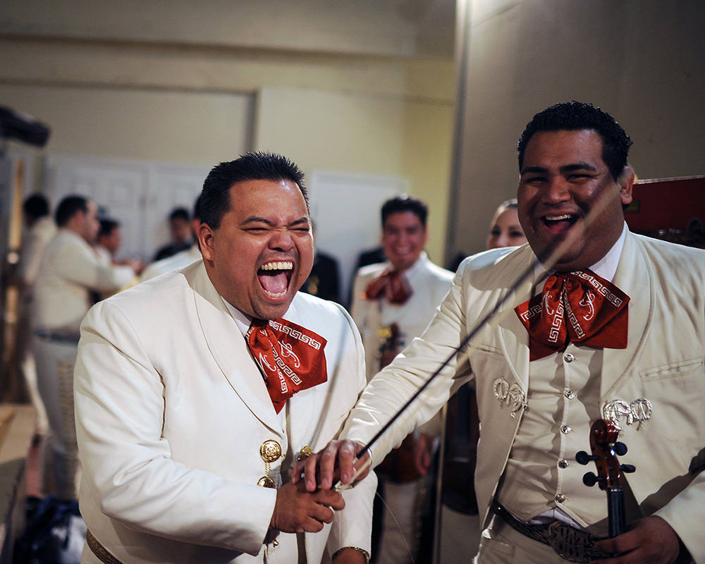 Mariachi Imperial de Mexico members Daniel Gonzales, left, and Misael Torbio laugh back stage before a grand finale with other bands during the Mariachi Festival at the Fox Theatre in Salinas, Calif. in 2012.