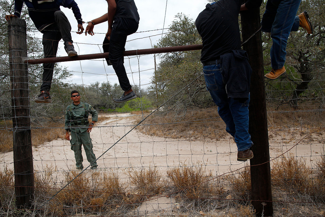 People are taken into custody by U.S. Border Patrol near Falfurrias, Texas, March 29, 2013. They were a part of a group reported as approximately 50 people who were attempting to circumvent the Falfurrias checkpoint. Immigrant deaths have increased in south Texas, in the areas around McAllen and Brownsville. So far the bodies of 70 immigrants have been found in the first three months of 2013, compared to 150 for all of 2012 and 66 for 2011. REUTERS/Eric Thayer (UNITED STATES)