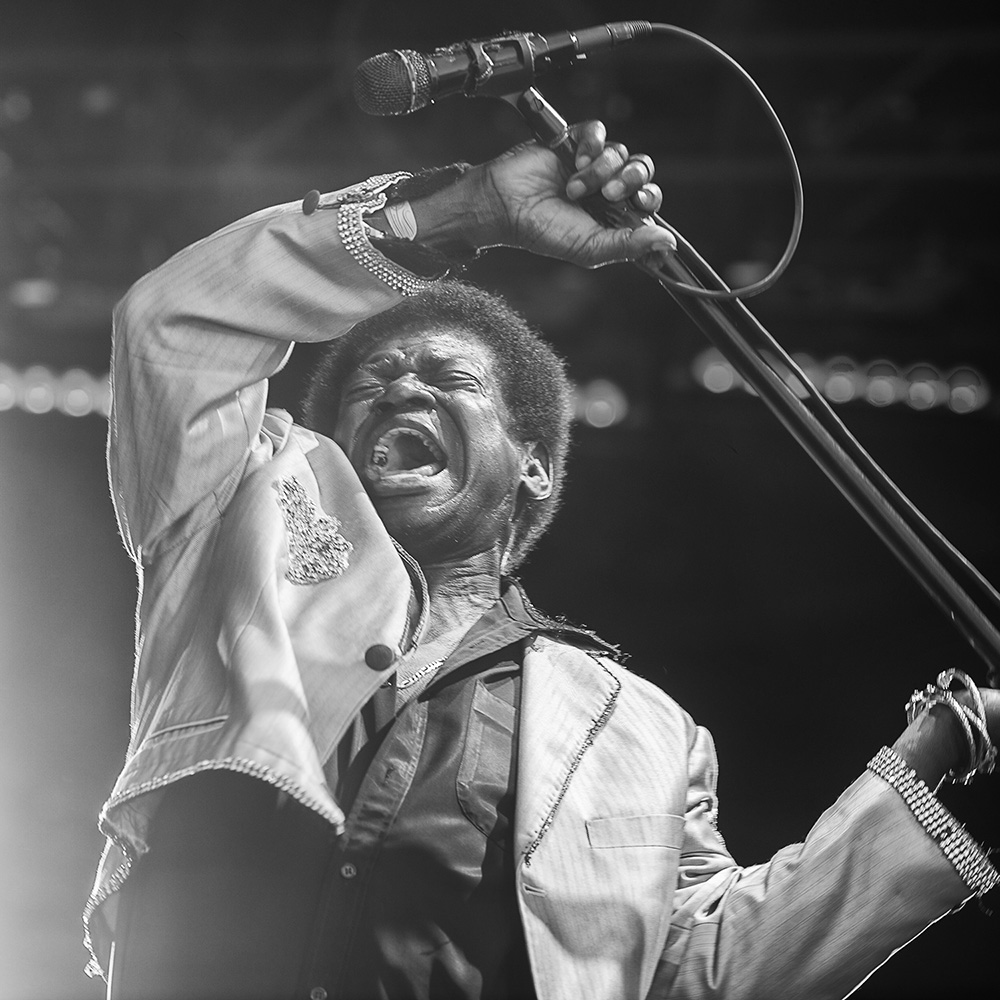 Charles Bradley pretends to smash his microphone while performing with The Extraordinares.