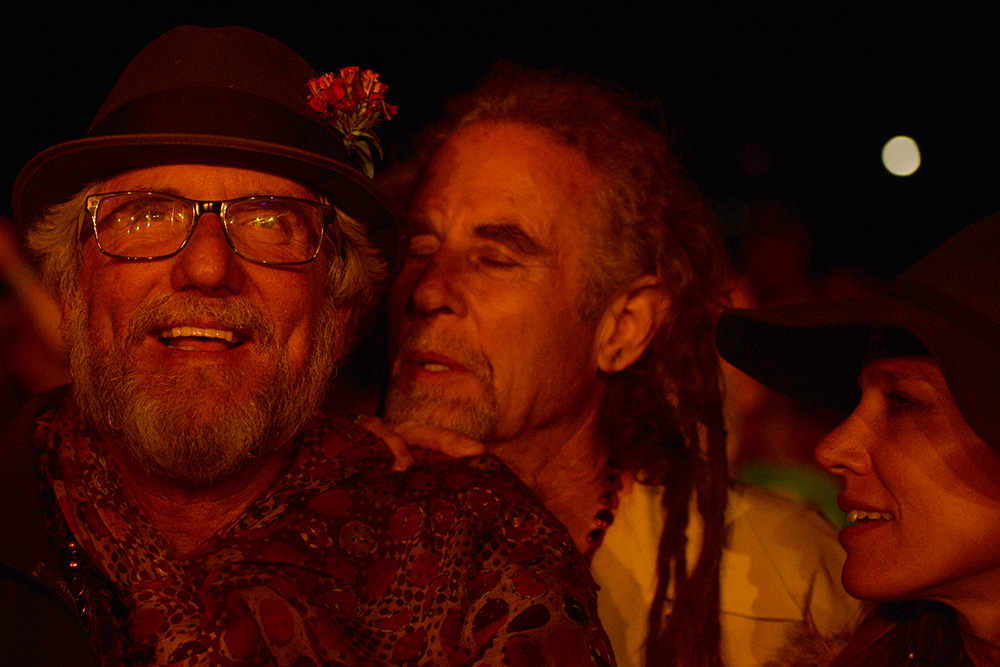 Two friends enjoy Phil Lesh performing at the Monterey International Pop Festival.