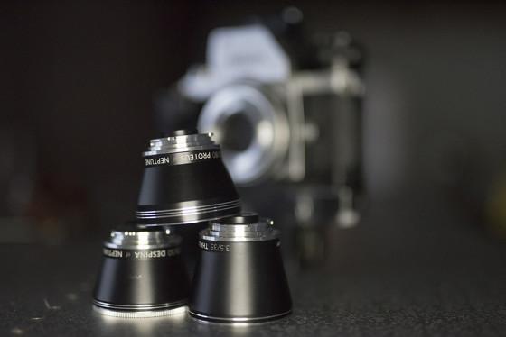 Neptune Lens System