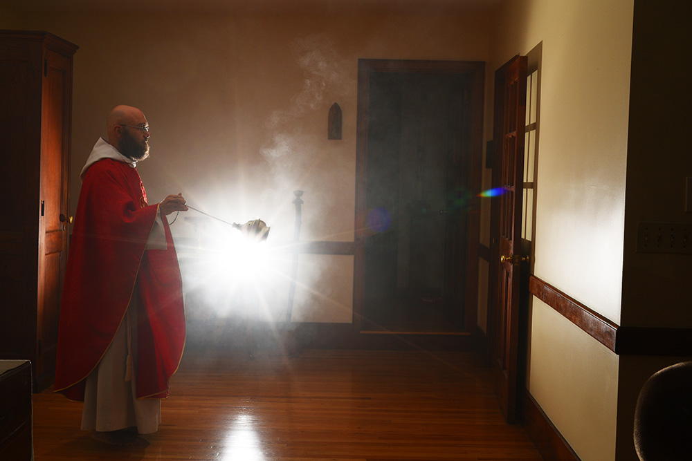 Father Sebastian (original name: Tomasz Kajko)  of the Franciscan Friars of the Renewal, a cloistered group of monks in Spanish Harlem, swings incense during early morning mass for his fellow friars at the St. Joseph's Friary on 142nd Street, Wednesday, October 18th, 2017.