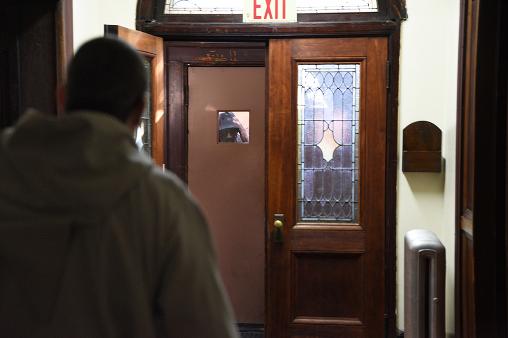 Father Glenn Sudano of the Franciscan Friars of the Renewal, a cloistered group of monks in Spanish Harlem, answers the door to a beggar looking for food at the St. Joseph's Friary on 142nd Street, Wednesday, October 18th, 2017.