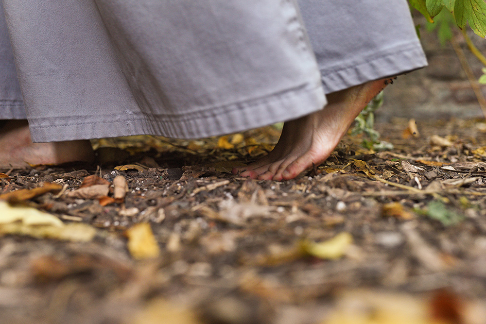 A Franciscan Friar of the Renewal walks barefoot, as is their custom, through the private gardens of the St. Joseph's Friary on 142nd Street, Wednesday, October 18th, 2017.